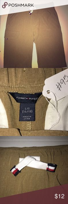 🇨🇷Tommy Hilfiger Boys Hybrid Shorts🇨🇷 These were NEVER worn and NWOT. My oldest thought he would wear them but he never did! Story of my life! There are two pairs, blue and khaki in my closet. Feel free to bundle for deal!! Tommy Hilfiger Bottoms Shorts