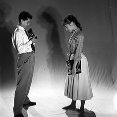 """The Italian photographer Pierluigi Praturlon photographed when he was photographing the actress Audrey Hepburn at the Cinecittà Studios, on Via Tuscolana, in Rome (Italy), during a break in the filming of """"War and Peace"""", in October 1955.Audrey was wearing:Shirt: Edith Head (of cotton in a shade of red with plaid in white, created at Audrey's request specially for her personal wardrobe, in 1954).Notes: Her hairstyle was done by Grazia De Rossi and her makeup by Alberto De Rossi (Grazia's…"""