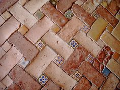 Granada,Spain | Tile inserts in brick. If these walkways could talk! Handmade tiles can be colour coordinated and customized re. shape, texture, pattern, etc. by ceramic design studios