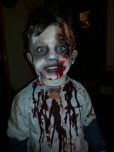 Easy Halloween child zombie.  Wet Oatmeal and  toilet paper then apply where you want it and hairspray. Next add eyeshadows and fake blood!