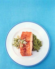 Scallion, onion, sugar, and white-wine vinegar make a flavorful topping for broiled salmon fillets. Serve this quick dish with rice and sauteed spinach.