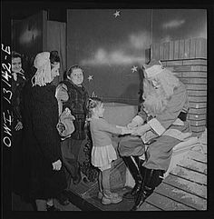 Macy's Santa in 1942:  This must have been a bitter-sweet job to have in '42, gently lowering those bright-eyed expectations..
