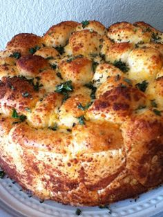 Garlic Bubble Bread is a delicious and easy bread recipe. Use Rhodes Rolls to make a pretty and tasty addition to any meal!
