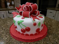 Very Cherry Birthday Cake - Vanilla cake with BC icing, covered in fondant w fondant cherries and gumpaste bow.