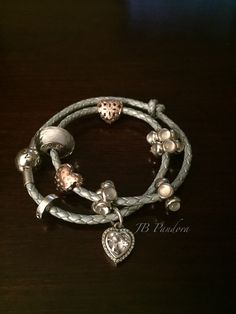 Pandora light blue leather bracelet with rose gold charms; Love and Appreciation 780003CZ Sparkle of Love781241CZ and white moonlight kiss cabochons.