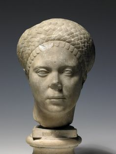 Marble portrait head from a statue of a woman, possibly Marciana Augusta, elder sister of the Emperor Trajan (AD98-117).