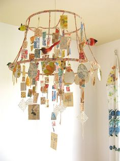 How creative? A DIY lampshade chandelier with whatever fabrics/materials you choose! I think I feel a less cluttery and rustic look with moss and birds and twigs coming on...