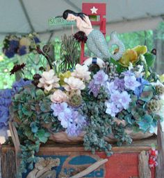 coney island mermaid float, succulents lady slipper orchids and ant dutch hydrangea