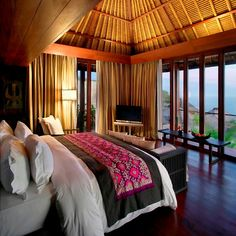 Vaulted bamboo ceilings, soft linens and Indian Ocean views are the order of the day at Bulgari Resort Bali.