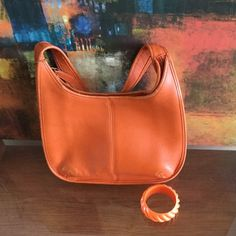 Coach Soho Collection Hobo Bag Authentic Coach Antique Orange Hobo Bag. The is some discoloration on the corner seams but on stains inside or out. The piping is in good condition. The shoulder strap is pristine. Coach Bags Hobos
