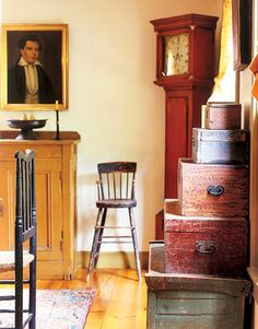 A house barely a decade old, is transformed into a New England colonial thanks in no small part to the grandfather clock in the corner.