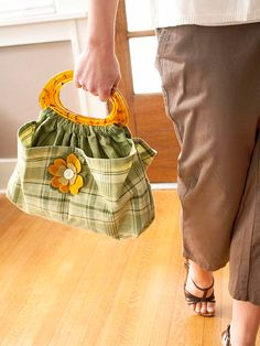Cute Flower Pin Handbag  It's the perfect bag for: Using those kitchen towels that are too cute to dry dishes with.   Add a special touch: Craft a wool flower pin that you can transfer to another bag, sweater, or coat.