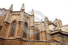 Photo about This is a side view of an old cathedral showing the radiating chapel around the ambulatory with decorative spires and arched windows. Image of buttresses, around, chapel - 81215288