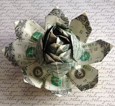 Making a dollar bill rose pinterest money rose saints and origami money lotus flower origami made of 12 one by moneyleisandcakes mightylinksfo