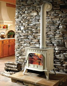 Wood stove in front of stone wall https://www.blackswanhome.com/uploads/images/Oakwood%20Wood%20stove%20ROOM%20lg.jpg Love the stone wall!