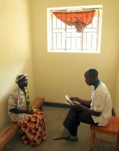 The results of her HIV test are conveyed to a villager by one of the trained volunteers. Photo: Omar Gharzeddine