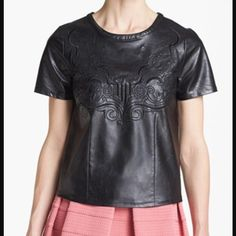 ASTR Leather Shirt NWOT Faux leather embroidered shirt. Zipper in back. Fits up to a small.  NWOT ASTR Tops