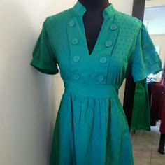 """Green Vintage style dress Emerald green dress. Not lined but could be the perfect Christmas dress with red tights. Great condition. Pullover style, ties at back. Length 35"""" Waist 30"""" Bust 38"""" sam & max Dresses"""