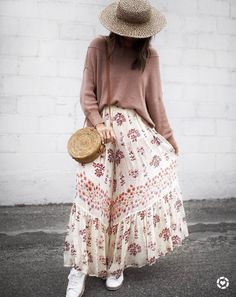 Wicker bag, sneakers and a maxi skirt. Love this combination. | 8 Stylish Accounts To Follow On Instagram | Isn't That Charming