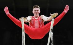 Nile Wilson (GBR) of United Kingdom competes on the parallel bars during the men's team final