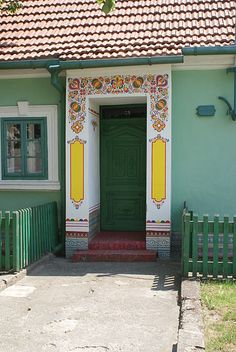 Cities that work preserve their cultural heritage through visual means, like this doorway in a small town in the Czech Republic