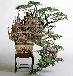 Japanese artist Takanori Aiba's  It's no wonder a former maze illustrator is the architect behind these incredibly detailed bonsai sculptures made of clay, epoxy putty, copper line, plastic, and resin.