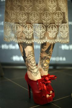 lace skulls, tattoos and red shoes