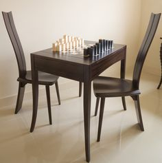 Zelouf And Bell Chess Pieces And Table And Chairs