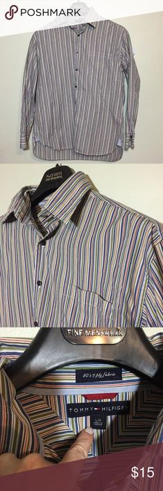 Tommy Hilfiger Men's Long Sleeve Striped Shirt L Tommy Hilfiger Men's Long Sleeve Striped Button Down. Shirt L, 100% cotton. Has blue, red and green stripes. Shown with sweater for styling options, sweater is also for sale. 127/100/122517 Tommy Hilfiger Shirts Casual Button Down Shirts
