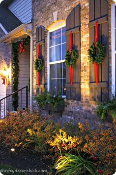 Festive outdoor decor See some pretty, traditional outdoor holiday decor at Thrifty Decor Chick! Christmas Window Decorations, Beautiful Christmas Decorations, Christmas Porch, Noel Christmas, Winter Christmas, Elegant Christmas, Christmas Wreath On Windows, Xmas Wreaths, Ribbon Wreaths