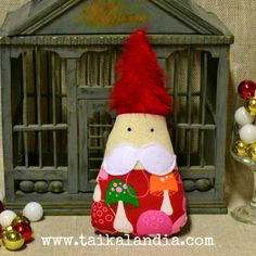 Cute and whimsical christmas gnome made of upcycled fabric by Taikalandia