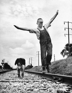The Meaning of Life...  A boy and his dog, Iowa,  Myron Davis