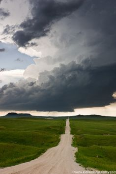 incredible supercell storm, a tornado can be seen on the left.