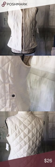 Croft & Borrow Cream Small NWT Vest This has pewter buttons and a white zipper. It has stretchy panels on the side for added comfort. It's made out of a quilted faux suede. The material is 100% polyester. The material is polyester, acrylic, and spandex. It is lined and filled with polyester. You can machine wash it. It has been tried on but it hasn't been worn. croft & barrow Jackets & Coats Vests