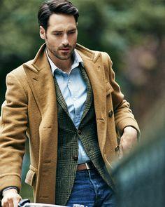 Camel coat. Green tweed blazer.
