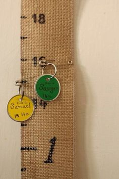 Burlap fabric ruler with markers/safety pins to indicate date, age, name, etc.