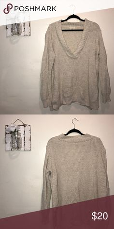 Cozy Urban Sweater Super cozy and warm cream sweater!! Deep vneck, small slits on both sides. Urban Outfitters Sweaters V-Necks