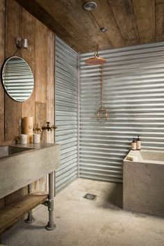 Corrugated steel walls and concrete vanity with metal legs via Unique Home Stays