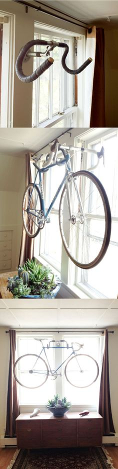 DIY  ::  wall bike hanger  ( Link :: http://kylethewilson.wordpress.com/2012/05/27/diy-wall-bike-hanger/ : )
