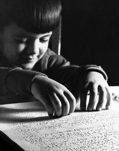 Blind boy reading Braille