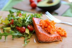 Crispy Salmon with Carrot-Ginger Relish and a little arugula salad. Great, easy way to dress up a simple broiled salmon fillet.