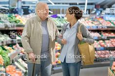 Assisted living - senior man with caregiver shopping royalty-free stock photo