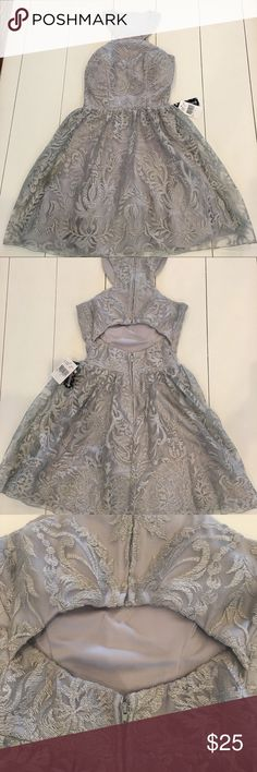 Silver Lace  Dress Size 1 NWT Brand New with tags juniors Extraordinary (Dillard's) dress. Beautiful silver and lace detail throughout with keyhole back. Small stain on underlining of dress as shown in last picture. Not visible when worn. Xtraordinary Dresses Mini
