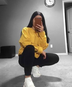 Urban casual: yellow hoodie paired with black leggings, perfect for those winter school days when you have no time to pick an outfit. Quick and easy.