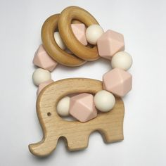handmade teething jewellery and accessories for babies. elephant shoe teething co. offers teething necklaces, teething bracelets, soother clips, teethers and onesies. Stylish and safe for mamas and babies.