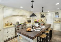 This kitchen design is great to showcase wide, open spaces.  The rich hood and stove area provides an open feeling to this smaller kitchen.