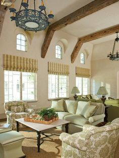 Beige French-Style Living Room with Green Chenille Couches and Steel Chandeliers - on HGTV