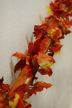 7.99 SALE PRICE! With its festive coloring and plush construction, the Maple Garland will bring a cheerful accent to your fall decor. The artificial maple le...