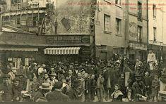 L'angle de la rue Saint-Médard et de la rue Mouffetard, un dimanche matin, vers 1900.