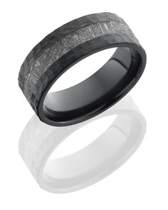"""Meteorite Ring... This ring is made from Gibeon Meteorite from Namibia and is believed to be 4 billion years old!      Lines and patterns in the meteorite are the result of cooling in outer space over billions of years and etching slices with dilute nitric acid allow these patterns known as """"Widmanstatten lines"""" to be more visible.      Meteoric iron is used for alignment and balancing, it symbolizes the aptitude and strength required for endurance.  Available at www.vermontdiamonds.com"""